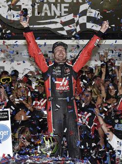 Kurt Busch, Stewart-Haas Racing Ford, celebrates after winning the Daytona 500