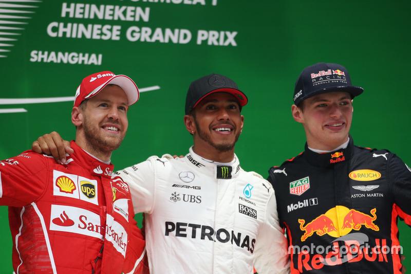 Sebastian Vettel, Ferrari Lewis Hamilton, Mercedes AMG, and Max Verstappen, Red Bull Racing, on the