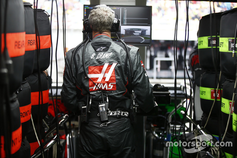 A Haas F1 Team engineer at work in the garage