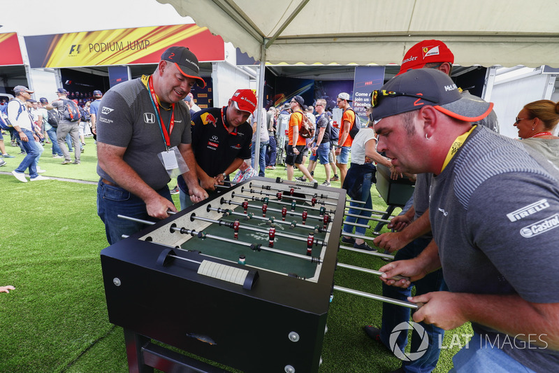 Fans play table football in the F1 Fanzone