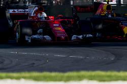 Sebastian Vettel, Ferrari SF70H, battles with Max Verstappen, Red Bull Racing RB13