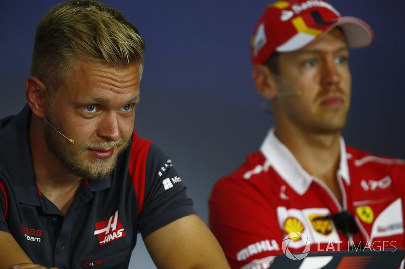 Kevin Magnussen, Haas F1 Team, Sebastian Vettel, Ferrari