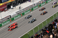 Sebastian Vettel, Ferrari SF71H and Kimi Raikkonen, Ferrari SF71H lead at the start of the race