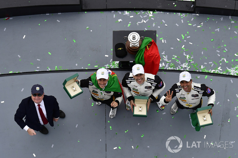 #5 Action Express Racing Cadillac DPi, P: Joao Barbosa, Christian Fittipaldi, Filipe Albuquerque, celebrate the win in victory lane with Rolex watches