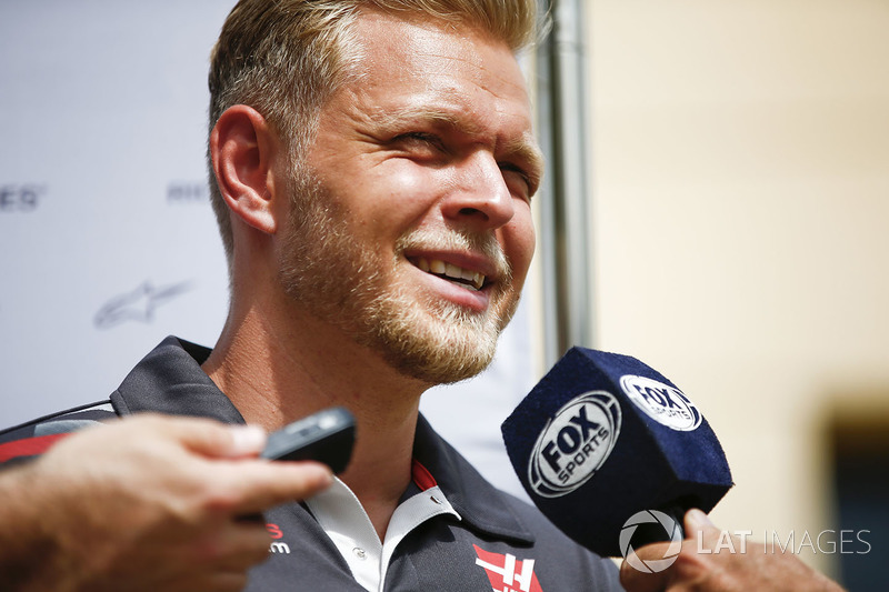 Kevin Magnussen, Haas F1 Team, talks to the press