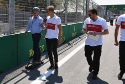 Marcus Ericsson, Sauber walks the track and talks with Johnny Herbert, Sky TV on a skateboard