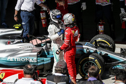 Race winner Sebastian Vettel, Ferrari celebrates in parc ferme with Valtteri Bottas, Mercedes AMG F1