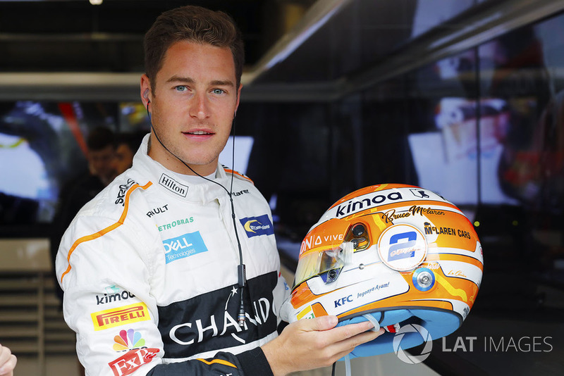 Stoffel Vandoorne, McLaren, shows off a new helmet design, with Bruce McLaren's name on it