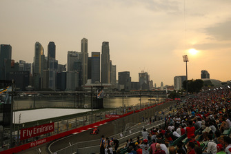 Fans watch Sebastian Vettel, Ferrari SF71H, in front of the Singapore skyline