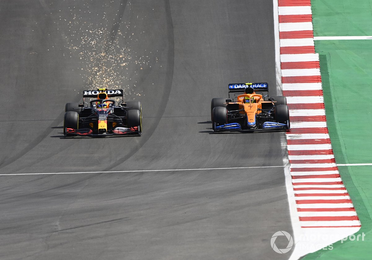Sparks fly as Sergio Perez, Red Bull Racing RB16B, battles with Lando Norris, McLaren MCL35M