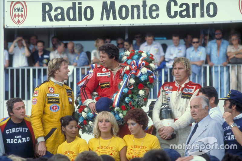 Podium: winner Mario Andretti, Team Lotus Ford, second place Ronnie Peterson, Team Lotus Ford, third place James Hunt, McLaren Ford