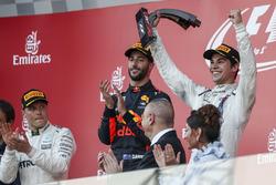Lance Stroll, Williams celebrates on the podium, the trophy alongside race winner Daniel Ricciardo, Red Bull Racing and Valtteri Bottas, Mercedes AMG F1