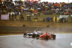 Michael Schumacher, Ferrari F310; Jacques Villeneuve, Williams FW18