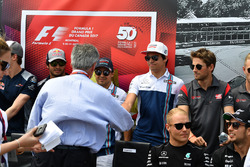 Chase Carey, Chief Executive Officer and Executive Chairman of the Formula One Group and Lance Stroll, Williams