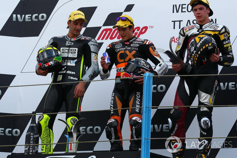 Podium: 1. Marc Márquez, 2. Andrea Iannone, 3. Scott Redding