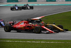 Sebastian Vettel, Ferrari SF70H and Nico Hulkenberg, Renault Sport F1 Team RS17 battle