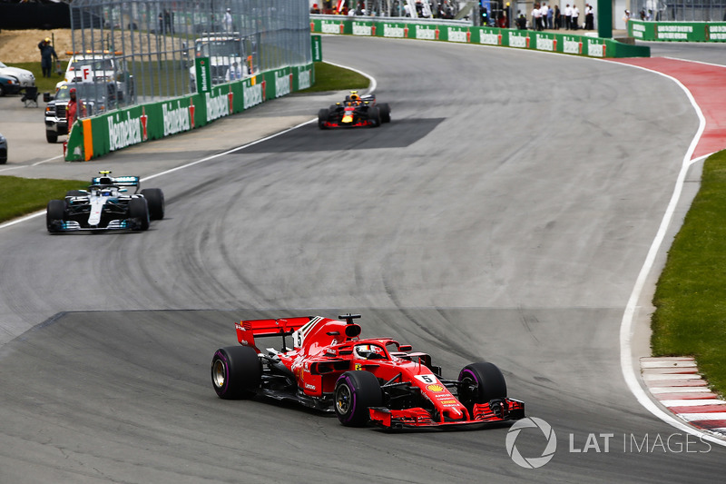 Sebastian Vettel, Ferrari SF71H, leads Valtteri Bottas, Mercedes AMG F1 W09, and Max Verstappen, Red