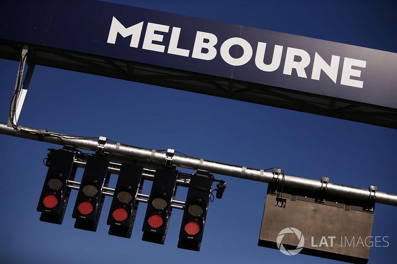Red lights are illuminated on the start gantry