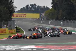Max Verstappen, Red Bull Racing RB13 and Sebastian Vettel, Ferrari SF70H battle at the start of the race
