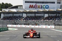 Sebastian Vettel, Ferrari SF70H, prepares to park his car after setting pole position