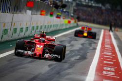 Kimi Raikkonen, Ferrari SF70H, Daniel Ricciardo, Red Bull Racing RB13, out of the pits