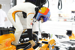 Fernando Alonso, McLaren, climbs into his cockpit