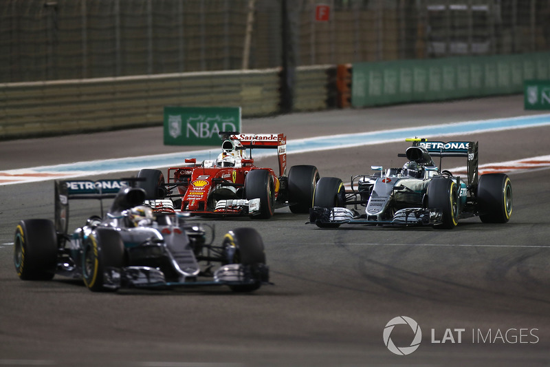 Sebastian Vettel, Ferrari SF16-H, battles with Nico Rosberg, Mercedes F1 W07 Hybrid, as Lewis Hamilton, Mercedes F1 W07 Hybrid, leads the race