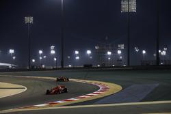Kimi Raikkonen, Ferrari SF71H, leads Daniel Ricciardo, Red Bull Racing RB14 Tag Heuer
