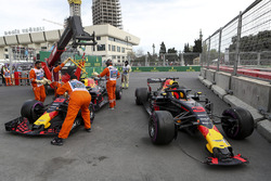 The crashed cars of Daniel Ricciardo, Red Bull Racing RB14 and Max Verstappen, Red Bull Racing RB14