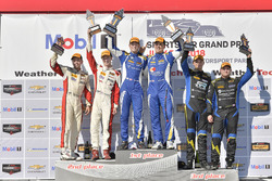 #81 BimmerWorld Racing, BMW 328i, ST: Nick Galante, Devin Jones celebrates the win on the podium #37 MINI JCW Team, MINI JCW, ST: Derek Jones, Nate Norenberg, #21 Bodymotion Racing, Porsche Cayman, ST: Max Faulkner, Jason Rabe