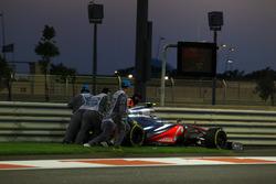 Marshals push away the car of Lewis Hamilton, McLaren MP4-27