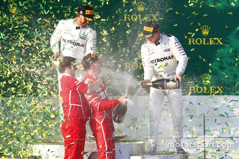 Race winner Sebastian Vettel, Ferrari, 1st Position, is joined by Luigi Fraboni, Head of Power Unit Race Operation, Ferrari, as they receive a soaking from Valtteri Bottas, Mercedes AMG, 3rd Position, and Lewis Hamilton, Mercedes AMG, 2nd Position