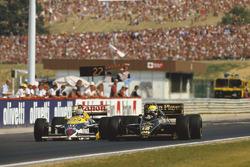 Ayrton Senna, Lotus 98T; Nigel Mansell, Williams FW11