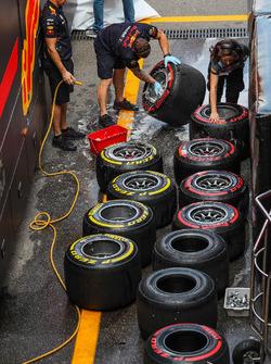 Red Bull Racing mechanics clean the Pirelli tyres