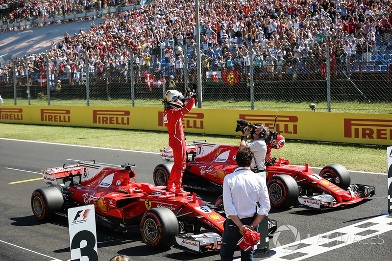Second place Kimi Raikkonen, Ferrari, polesitter Sebastian Vettel, Ferrari celebrate in parc ferme