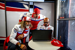 Alex Ghini, Pramac Racing hospitality manager, Federico Cappelli, press officer, and Jacopo Menghetti, marketing manager.