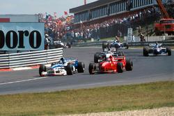 Damon Hill. Arrows A18 overtakes Michael Schumacher, Ferrari F310B