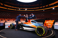 Yusuke Hasegawa, Senior Managing Officer, Honda, Zak Brown, Executive Director of McLaren Technology Group, Eric Boullier, Racing Director, McLaren, and presenter Simon Lazenby toast the McLaren MCL32