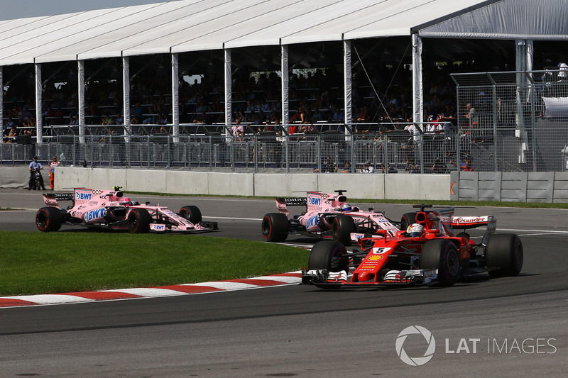 Sebastian Vettel, Ferrari SF70H leads Sergio Perez, Sahara Force India VJM10 and Esteban Ocon, Sahara Force India VJM10