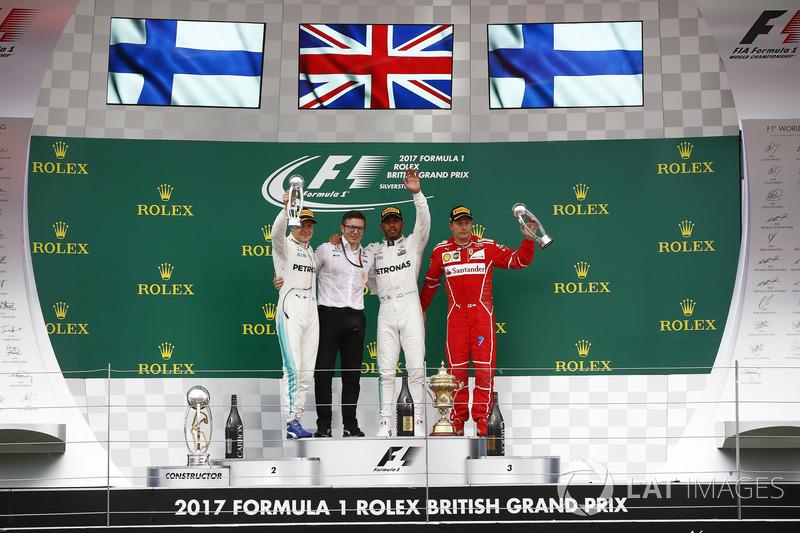 Second place Valtteri Bottas, Mercedes AMG F1, Peter Bonnington, Race Engineer, Mercedes AM, Race winner Third place Lewis Hamilton, Mercedes AMG F1 Kimi Raikkonen, Ferrari, on the podium