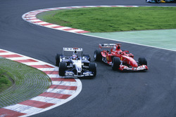 Juan Pablo Montoya, Williams overtakes Michael Schumacher, Ferrari at Bus stop