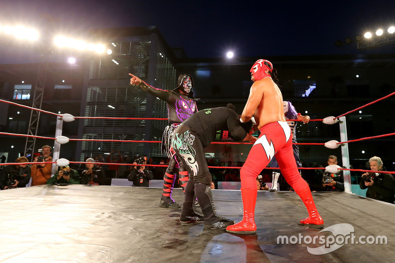 Mexican wrestlers in the paddock
