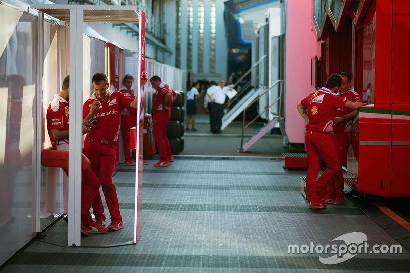 Ferrari mechanics in the paddock