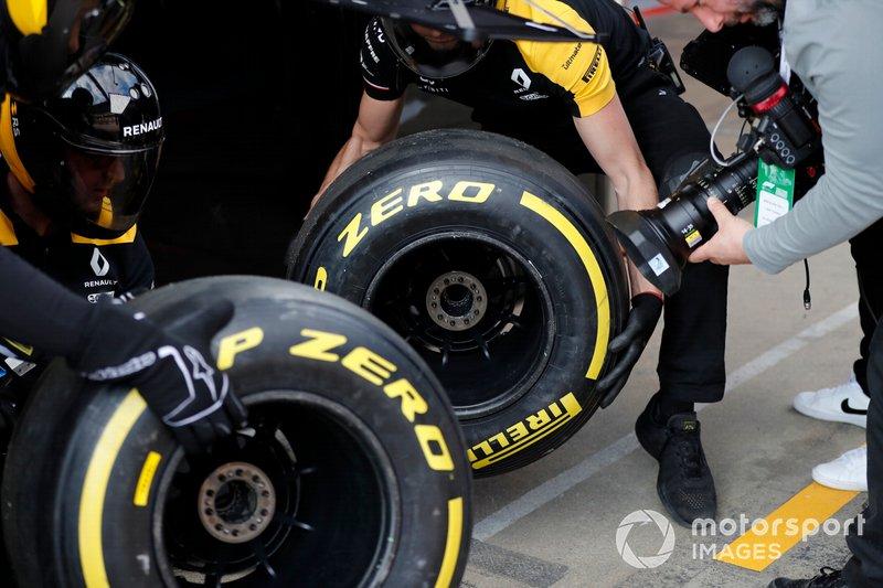 Renault F1 Team mechanics with Pirelli tyres and cameraman