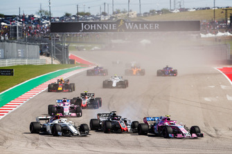 Esteban Ocon, Racing Point Force India VJM11, battles with Charles Leclerc, Sauber C37, and Romain Grosjean, Haas F1 Team VF-18, ahead of Sergio Perez, Racing Point Force India VJM11, Kevin Magnussen, Haas F1 Team VF-18, and the remainder of the field at the start