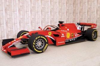 Cardboard F1 car with Ferrari livery