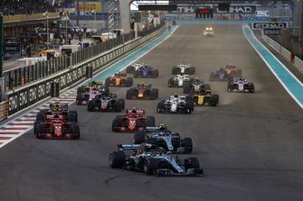 Lewis Hamilton, Mercedes AMG F1 W09 EQ Power+, leads Valtteri Bottas, Mercedes AMG F1 W09 EQ Power+, Sebastian Vettel, Ferrari SF71H, Kimi Raikkonen, Ferrari SF71H, Daniel Ricciardo, Red Bull Racing RB14, Max Verstappen, Red Bull Racing RB14, and the rest of the field at the start of the race
