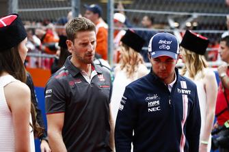 Romain Grosjean, Haas F1 Team, talks to Sergio Perez, Racing Point Force India