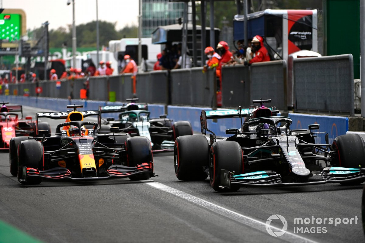 Lewis Hamilton, Mercedes W12, Max Verstappen, Red Bull Racing RB16B, in the pit lane