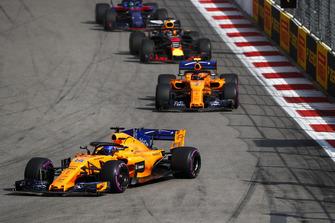 Fernando Alonso, McLaren MCL33, leads Stoffel Vandoorne, McLaren MCL33, and Daniel Ricciardo, Red Bull Racing RB14